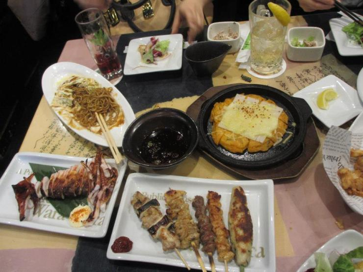 Izakaya - cheap food and drinks.